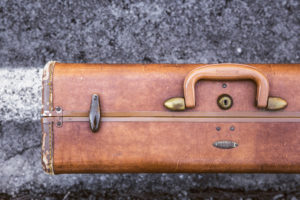 z. Old Tan Briefcase on Road
