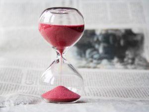 1-hourglass-on-newspaper